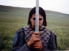 Young man dressed as knight