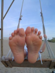 feet on a swing