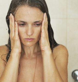 Anxious woman in the shower