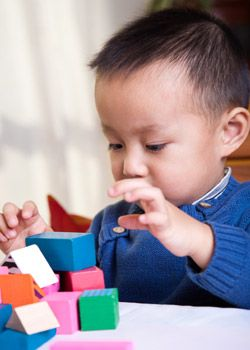 A boy plays with blocks