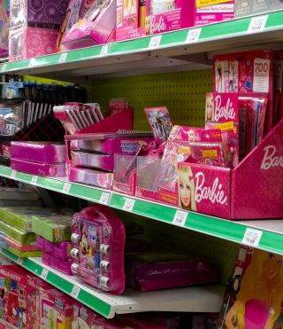 Image of pink Barbie products at a toystore