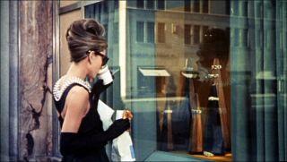Audrey Hepburn has breakfast at Tiffany's. Public domain image.