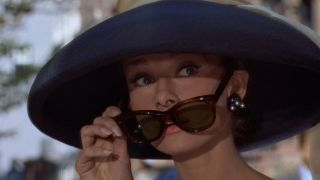 """Even Holly Golightly's Wayfarers couldn't block out the """"mean reds."""" Wiki Commons public domain image"""