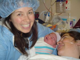 doula with mother and baby