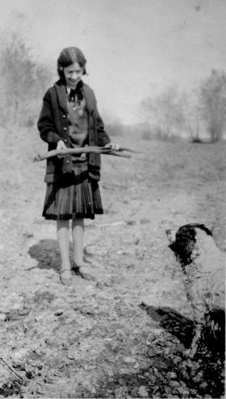 Girl with stick and dog