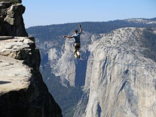 Man highlining at Taft Point in Yosemite National Park with El Capitan in the background.