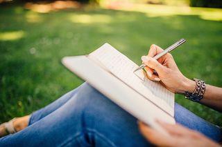 Woman writing. Pixabay, Public Domain.