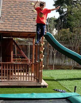 Mike Lanza, used with permission.  Nico leaping from playhouse roof to trampoline