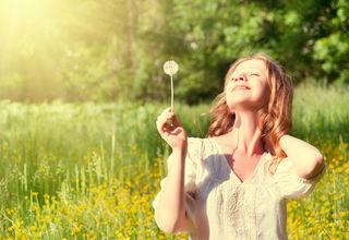 "Purchased from Deposit photos, Copyright evgenyatam, ""Beautiful girl enjoying the sun"""