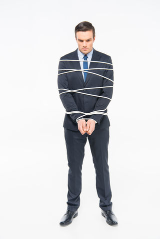 Young roped businessman–© silentgor
