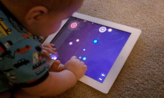 Baby playing NodeBeat on the iPad2 by lynnmarentette /Flickr/is licensed under CC BY 2.0.