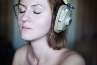 """Woman Listening through Headphones"" by Kashirin Nickolai / Wikimedia Commons  / CC BY 2.0"