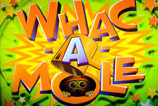 Whac a Mole by Thomas Hawk Flickr Licensed Under CC BY 2.0