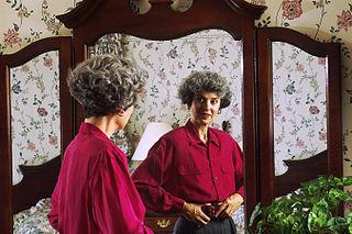"""""""Woman Looking in a Mirror,"""" by Bill Branson, Wikimedia.org"""