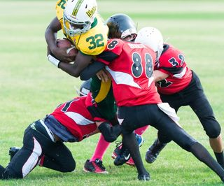 """Youth Football,"" by Ronald Carlson/ Publicdomainpictures.net"