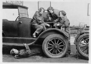 [High school girls learn the art of automobile mechanics], [1927], LC-USZ62-111359, National Photo Company Collection, Library of Congress.