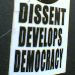 Dissent sticker by jason wilson at Flickr (CC BY 2.0)