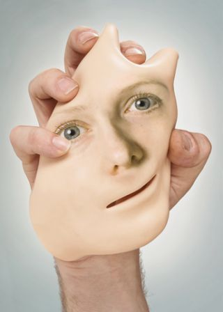 hand squeezing mask of human face