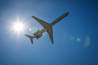 Jet Airplane In The Sky With Sun by alex grichenko, public domain license