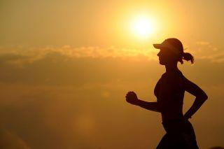 Woman running in the setting sun