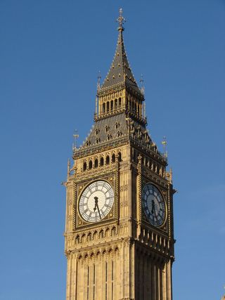 United Kingdom Clock Clock Tower London England by chrgrhart licensed under CC0