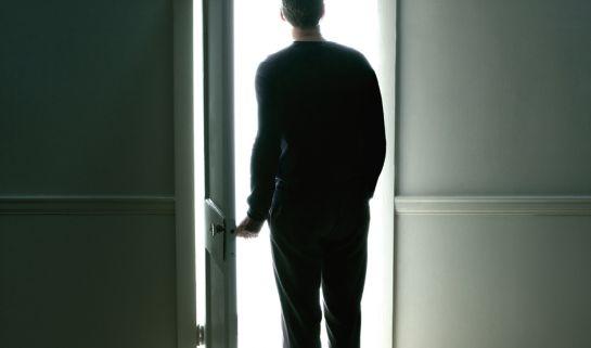 Image: Man's silhouette in a sunlit doorway