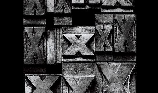 """Image: Collection of black and white """"X"""" stamp blocks"""