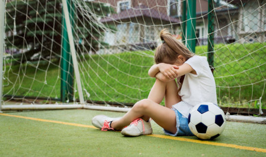 Little girl crying at soccer practice.