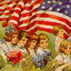 Children carrying the American flag and flowers