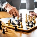 Beating stigma requires strategies like a game of chess.  Who should lead the game?