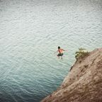 Man jumping on body of water