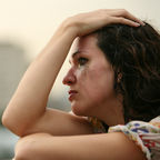 http://www.istockphoto.com/photo/a-woman-leans-with-her-hand-on-the-top-of-her-head-gm144288581-3961884