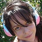 Wikimedia Commons/Brazilian Girl Listening To Music With Pink Headphones by lsalinsky/CC By SA 3.0