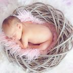 https://www.pexels.com/photo/baby-sleeping-in-a-basket-and-a-round-feather-surrounding-the-basket-34763/