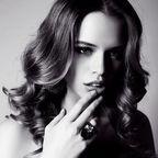 © Svyatoslava Vladzimirskaya   Beautiful sensual woman with dark hair with fur