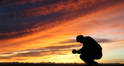 Image result for man sitting distressed in sunset
