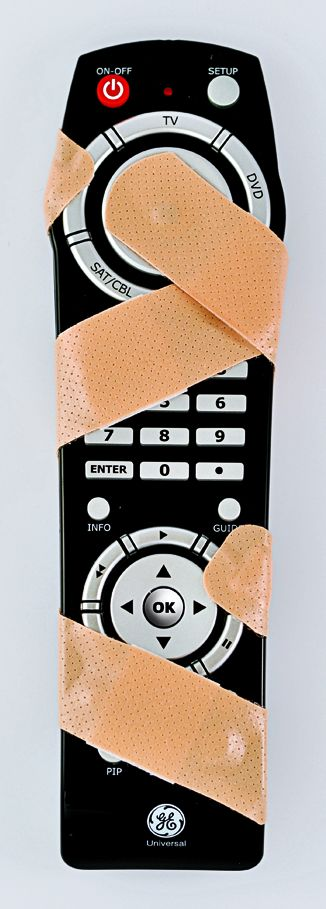 Remote control covered in bandaids