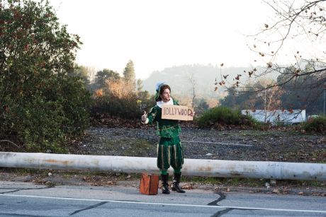 Hitchhiking storyteller w/ Hollywood sign