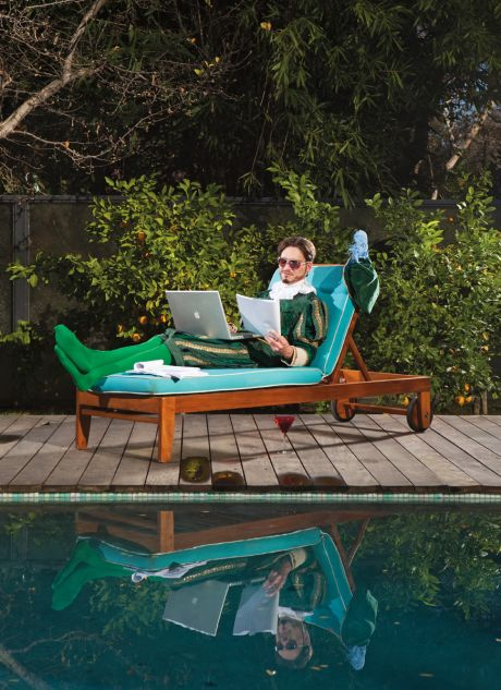 Storyteller lounging by a pool with a script