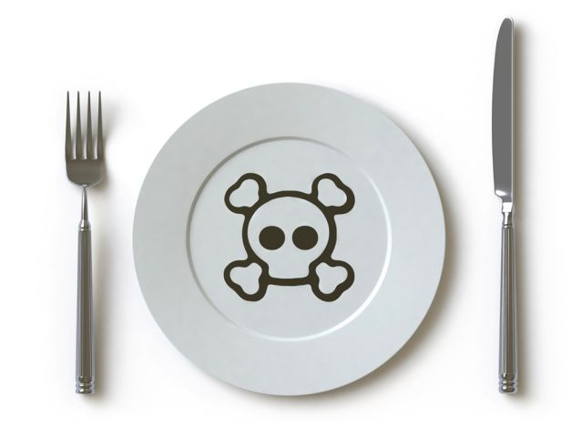 Dinner place setting w/ poison logo