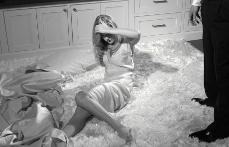 Woman on the floor w/ sheets