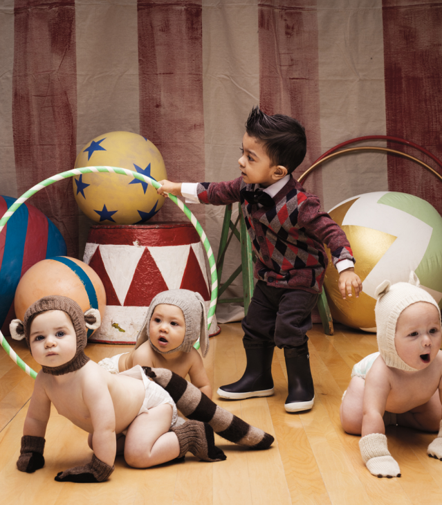 Babies dressed as animals crawling thru hoops