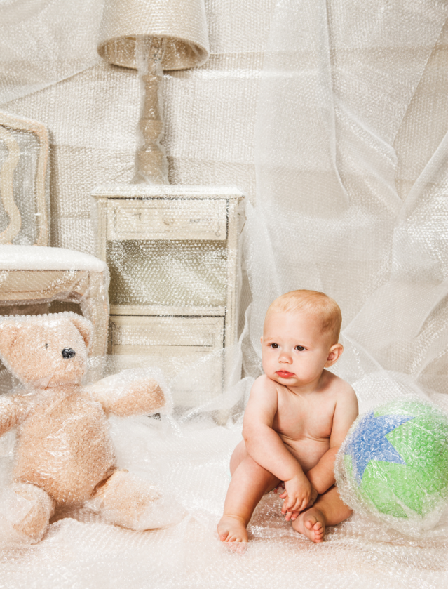 Baby in a bubble-wrapped nursery