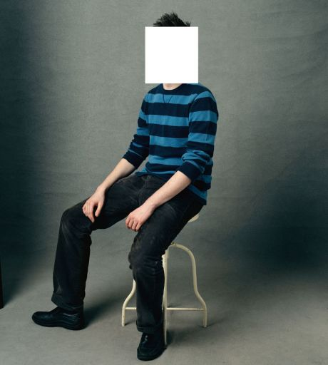 Boy on chair face hidden