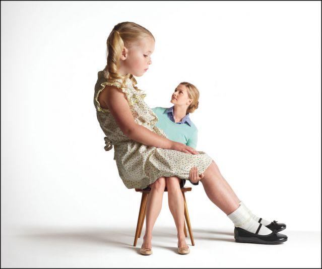 Giant child on shrunken mother's lap