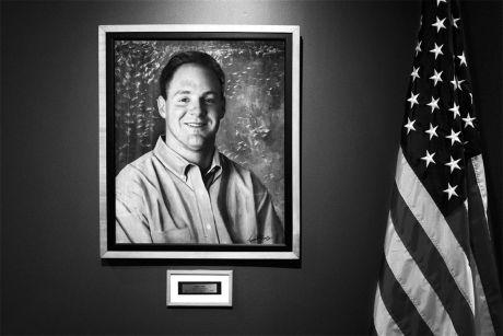Portrait of Daniel Lewin displayed in Akamai's lobby