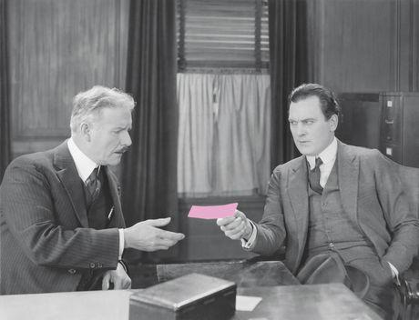 Boss handing out pink slip