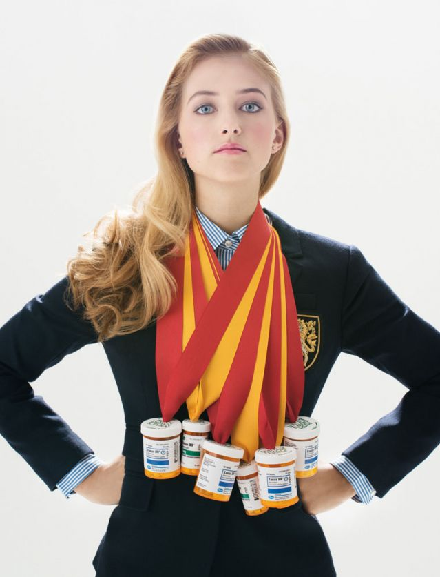 Private school girl with pharma containers hanging from award ribbon