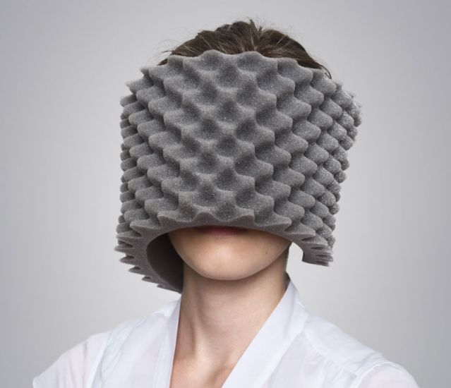 woman with egg crate foam covering her face