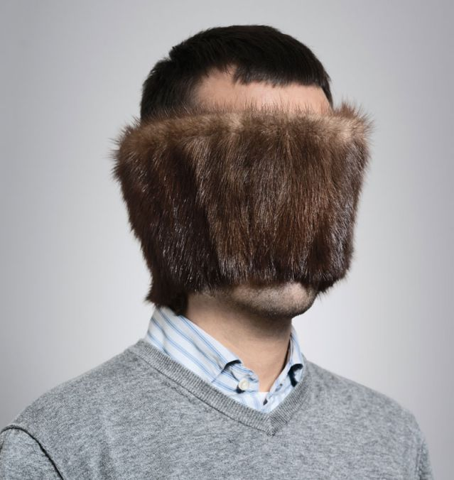 Man with fur covering his face
